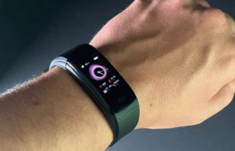 hand photo with a fitness tracker on it